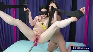 Pale skin teen is blindfolded, suspended and fucked by sex machine