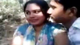 Bangladeshi young couple having fun in park