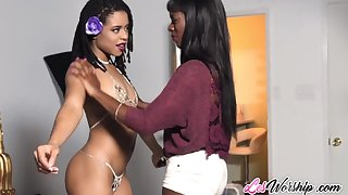 Small tits ebony model gets lesbian licked while on photo shoot